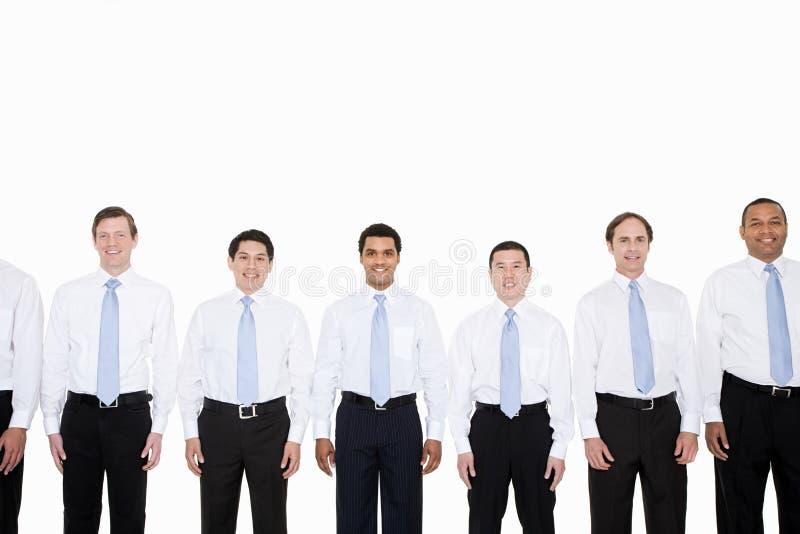 Simili uomini d'affari di sguardo in una fila fotografia stock
