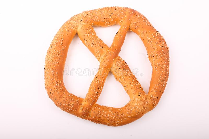 Fresh Simit. Simit with sesame on white plate on white background royalty free stock images