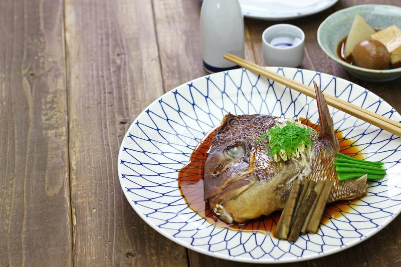 Simmered sea bream head, japanese cuisine. Simmered sea bream head, tai no kabutoni, japanese cuisine stock photo