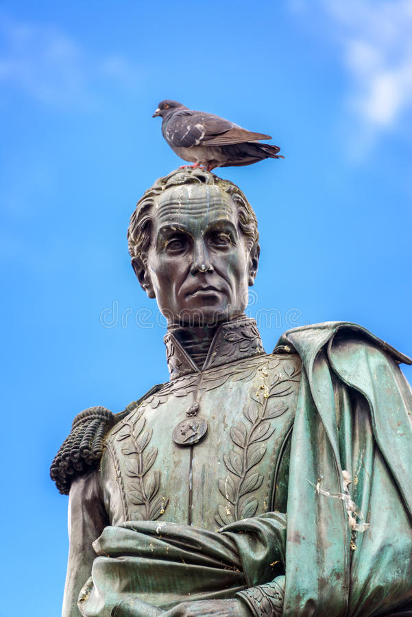 Simon Bolivar Stature. Pigeon standing on the head of a statue of Simon Bolivar in the Plaza de Bolivar in the center of Bogota, Colombia stock images