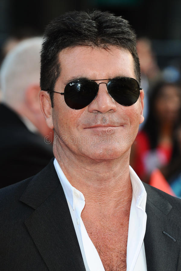 Simon Cowell. Arriving for the 'One Direction: This is Us' World premiere at the Empire, Leicester Square, London. 20/08/2013 Picture by: Steve Vas / stock photography
