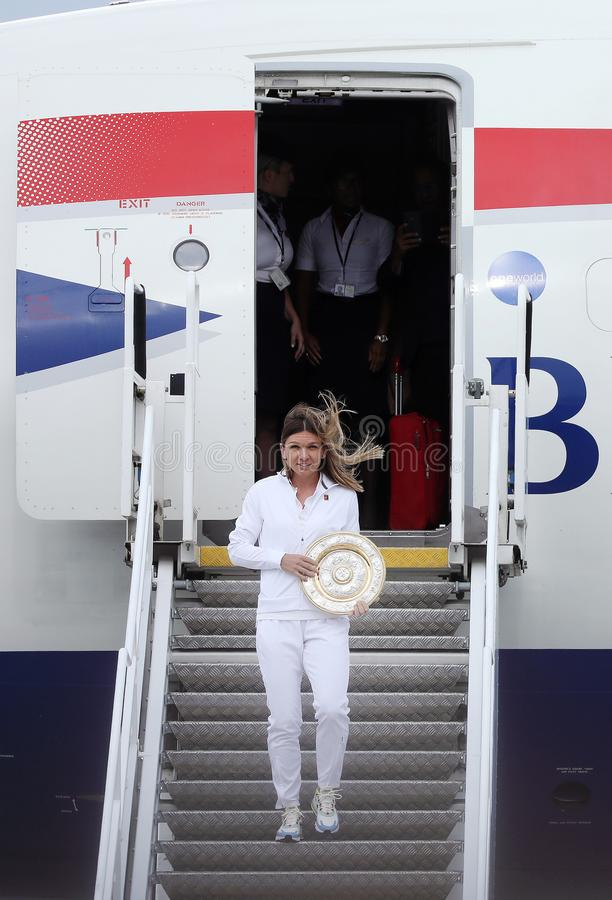 Simona Halep returns home with Wimbledon trophy royalty free stock images