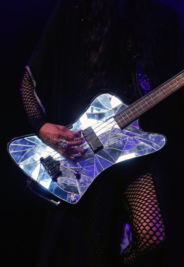 Simonne jones bass guitar reflections detail. Reflections over the bass guitar of US born producer, singer, composer, model and visual artist based in Berlin stock photography