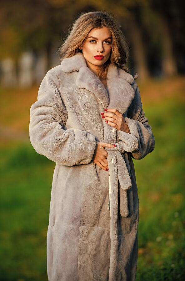 Free Simple And Warm. Sexy Woman Red Lips Wear Fur Coat. Businesswoman In Fur Coat. Glamorous Lady. Cosy Autumn Outfit Royalty Free Stock Photography - 207192377