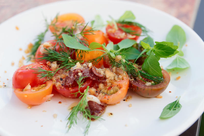 Simple appetizer with cherry tomatoes and duck meat stock photography