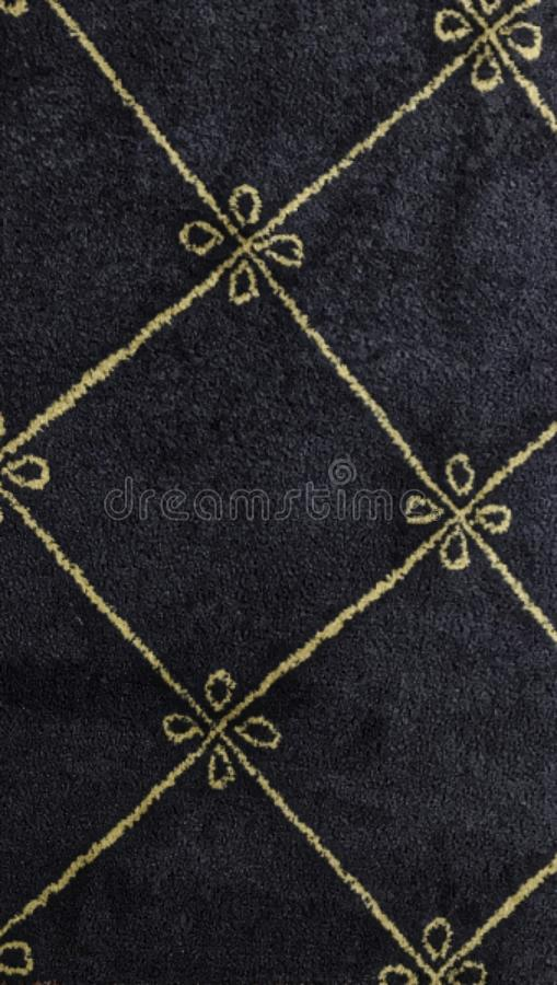 Simple Area Rug design. Blue carpet background with gold lines embroidered. Onto the blue background. This design was inspired from a larger carpet design at stock photos