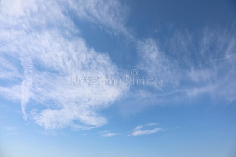simple background of blue sky and white clouds royalty free stock photo