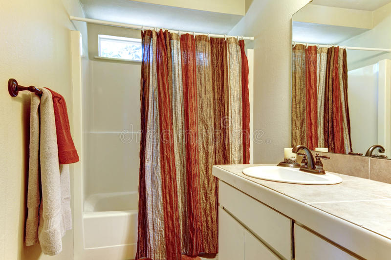 Download Simple Bathroom With Red And Browns Colors In Shower Curtain Stock Photo