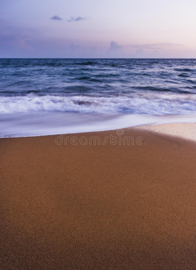 Simple beach sunset shot in long exposure.Copy space. Amazing Greece royalty free stock photo