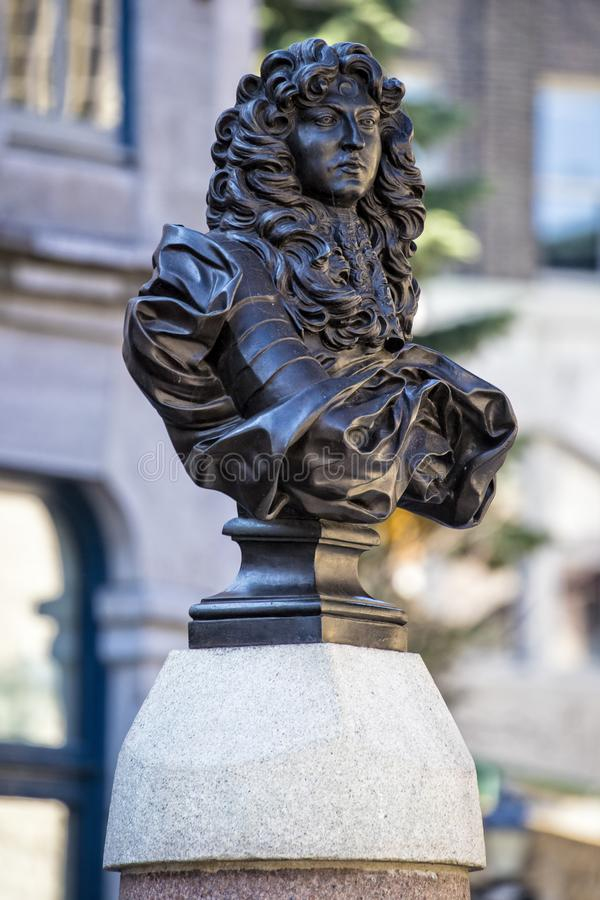 Simple beautiful french statue outside in Quebec City Canada. With building in background stock image