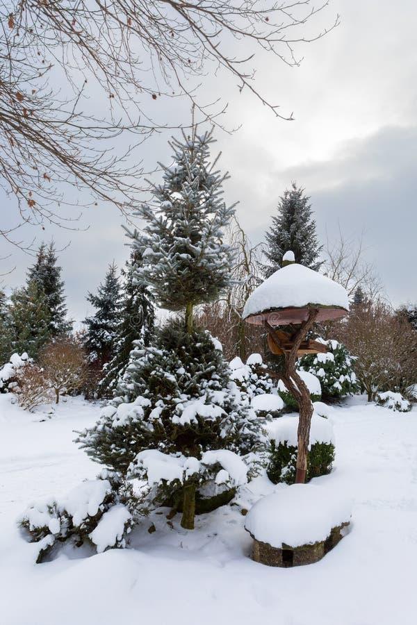 Simple bird feeder, birdhouse in winter stock image