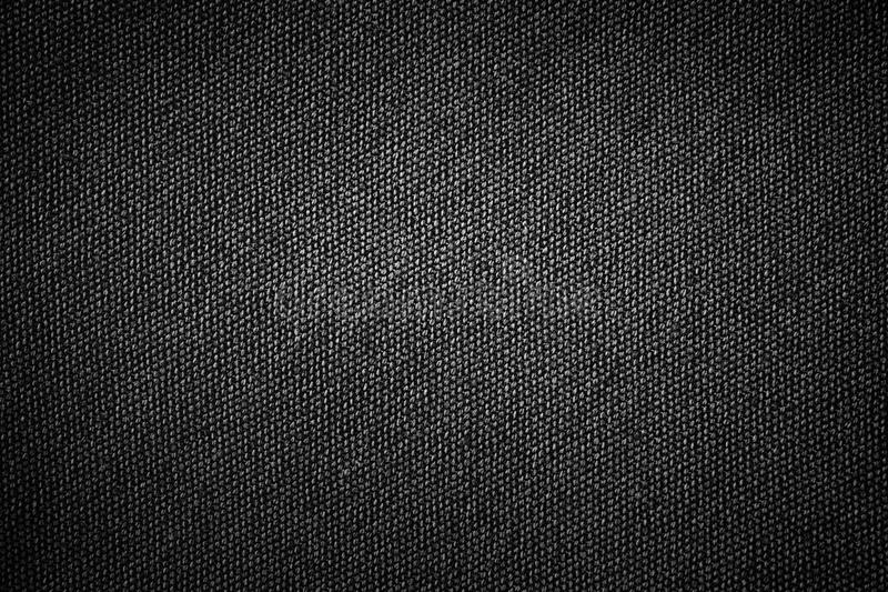 Simple black background sackcloth fabric texture with gray gradient light abstract for product or text backdrop design royalty free stock images