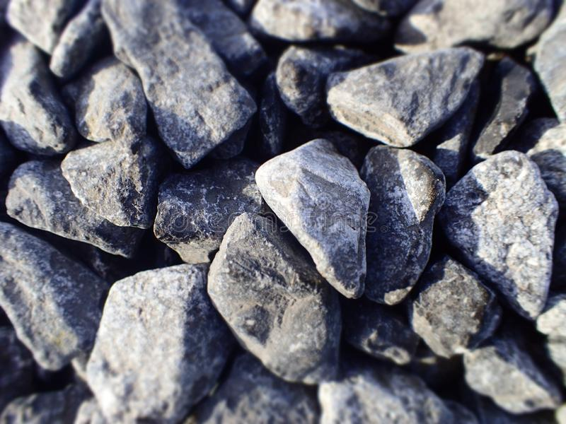 Simple black and white. Small pieces of stone. small rocks or gravel. Many small make a big effect. Structure of nature. Pavement in the garden.. It comes from royalty free stock images