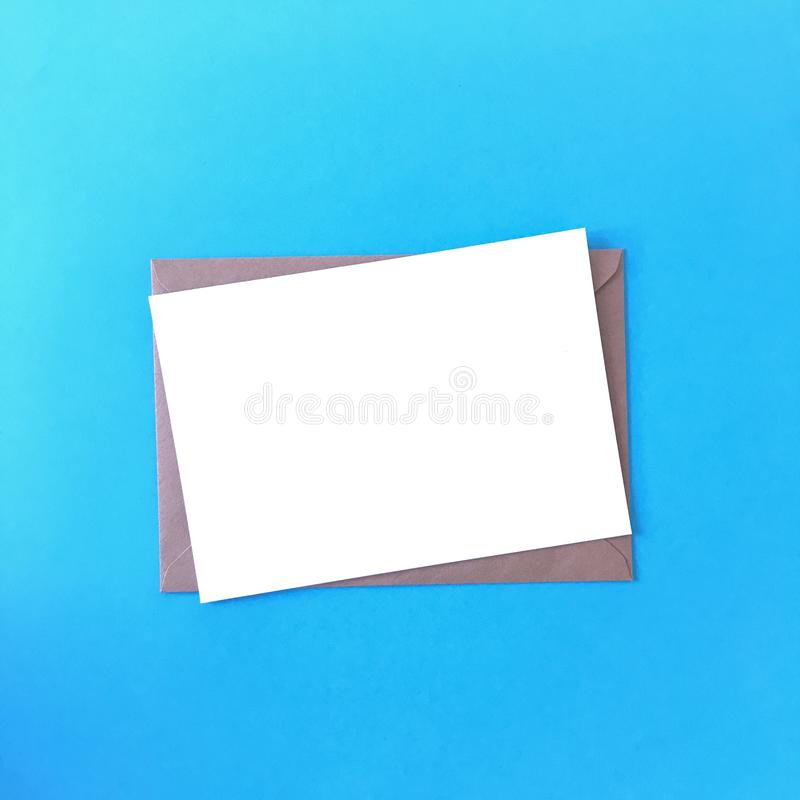 Simple Blank Postcard Mockup on Blue Background stock photography