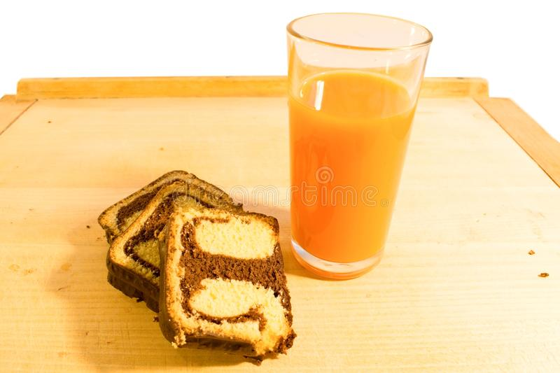 Simple breakfast chocolate roll with carrot juice stock photos