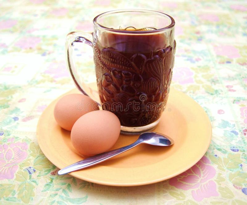 Simple breakfast of coffee and eggs. A mug of natural coffee with two eggs are a quite simple breakfast. a healthy breakfast should contain some protein and stock photos
