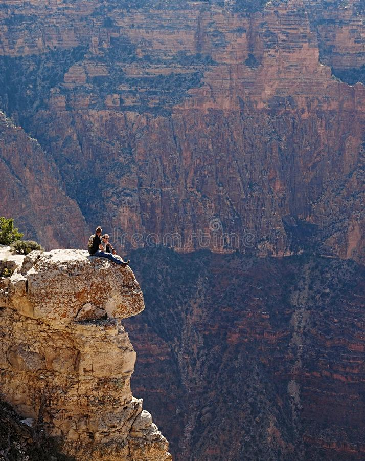 A simple chat around the edges of the South Rim - AZ -. It`s very dangerous to venture to the edges of the Gran Canyon indeed. A lot of people have lost the life royalty free stock photography