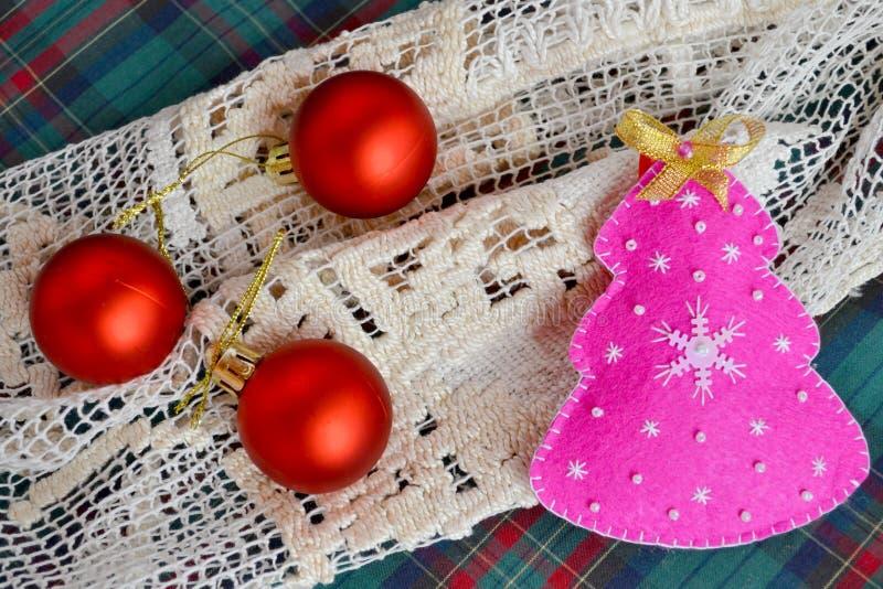 Handmade felt Christmas tree. Children crafts. Funny felt crafts. Simple Christmas crafts. Christmas holiday ornaments. Christmas felt ornaments. Cute and simple royalty free stock photos