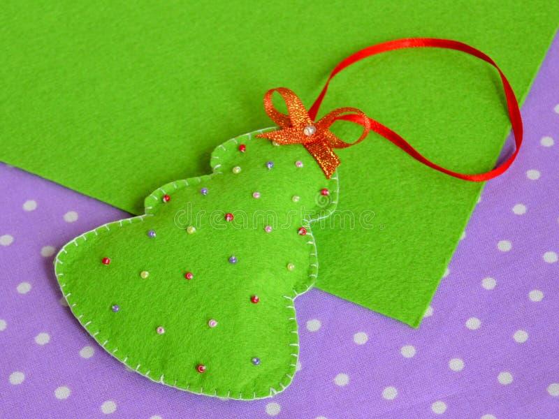 Handmade Christmas tree of felt. Kids craft. Simple Christmas crafts. Christmas holiday ornaments. Christmas felt ornaments. Cute and simple Christmas crafts stock image