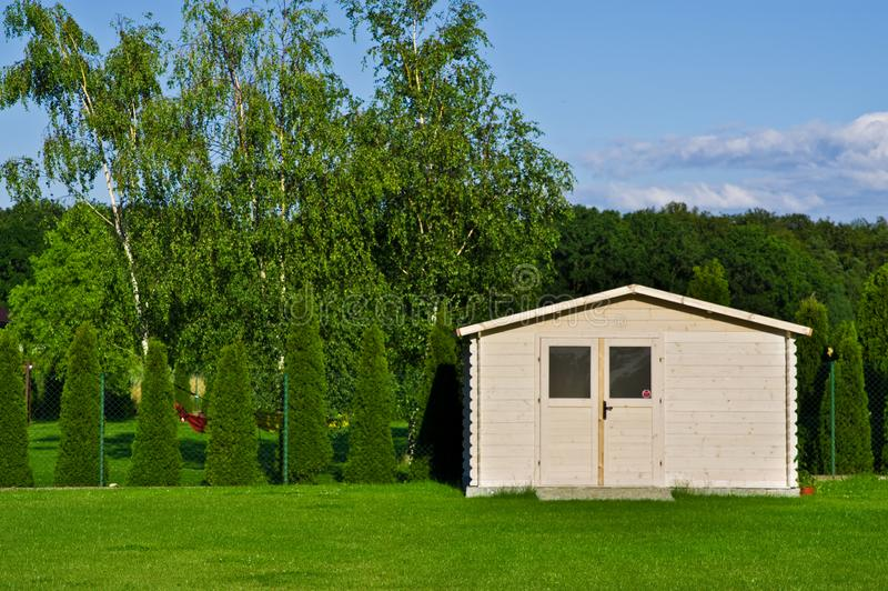 New garden house or shed in green lawn or grass royalty free stock photos