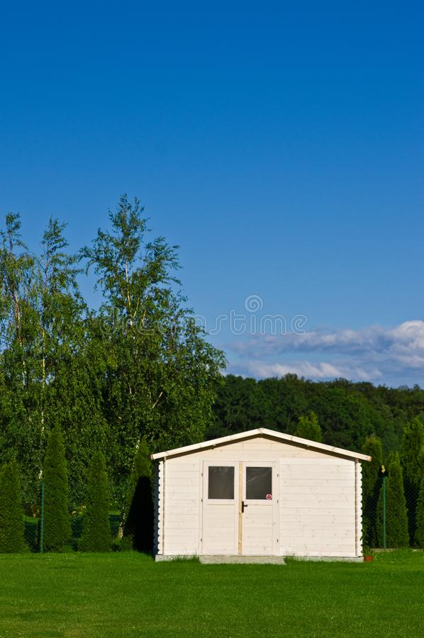New garden house or shed in green lawn or grass stock images