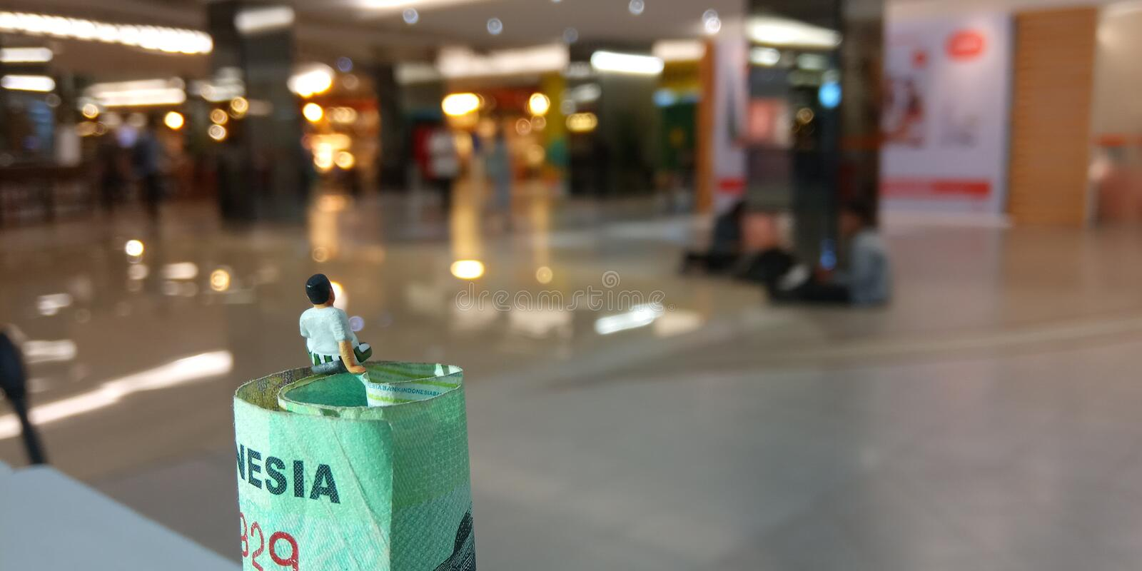 Simple conceptual illustration photo for consumerism life style, old man using kopiah, sarung, indonesia, malaysia and other asia stock photography