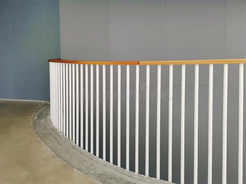 Curved Balcony with White Fencing Rods and Wood Rail stock photography