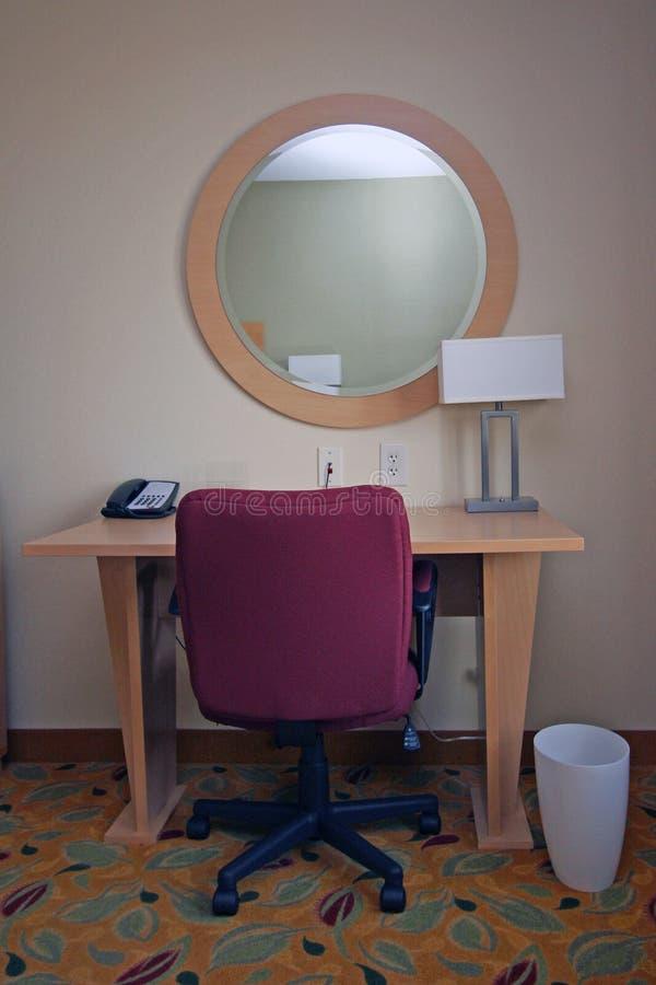 Simple desk, mirror, chair royalty free stock photos