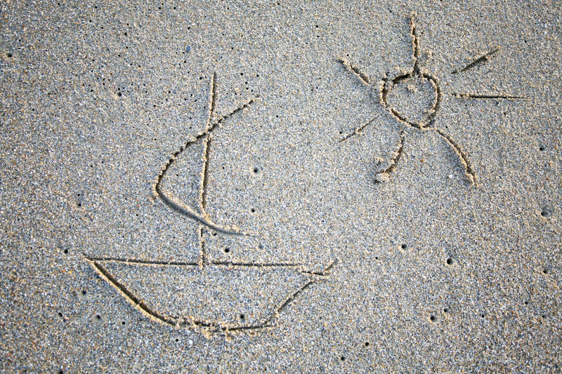Simple drawings on the sand. Simple drawings of yacht on the sand stock photos
