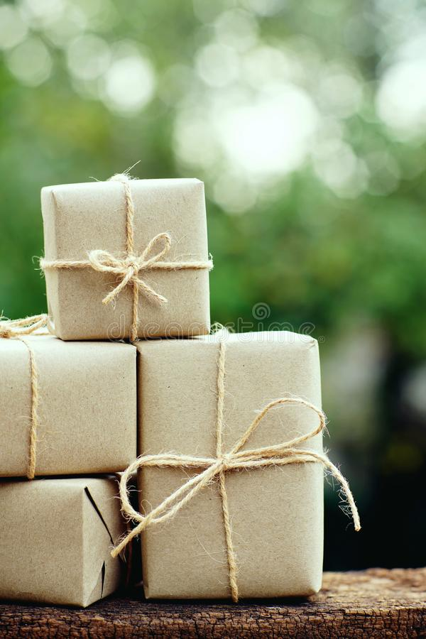 Simple eco friendly gift boxes package wrap with brown paper, green present concept, copy space stock images