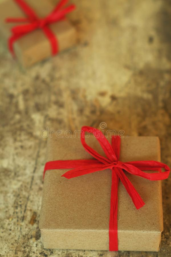 Simple eco friendly gift boxes package wrap with brown paper in old wooden table background, green present concept royalty free stock photography