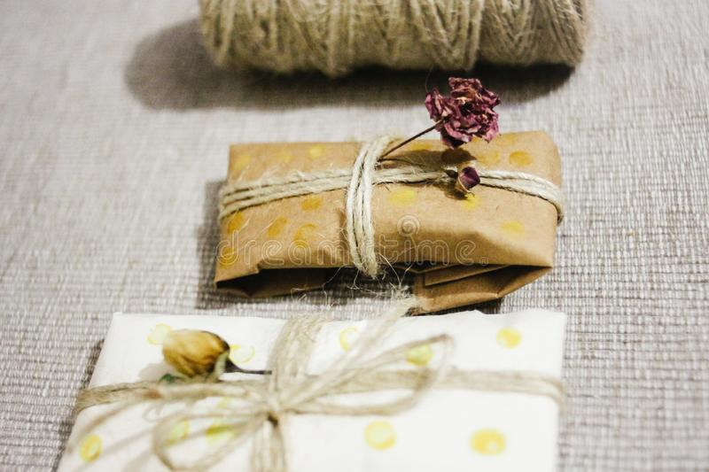 Simple eco wrap packaging gift in craft paper, rustic presents. Simple eco wrap packaging gift in craft paper royalty free stock photo