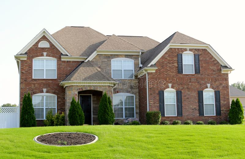 Simple Elegance Two-Story Brick and Cobblestone Home royalty free stock photo