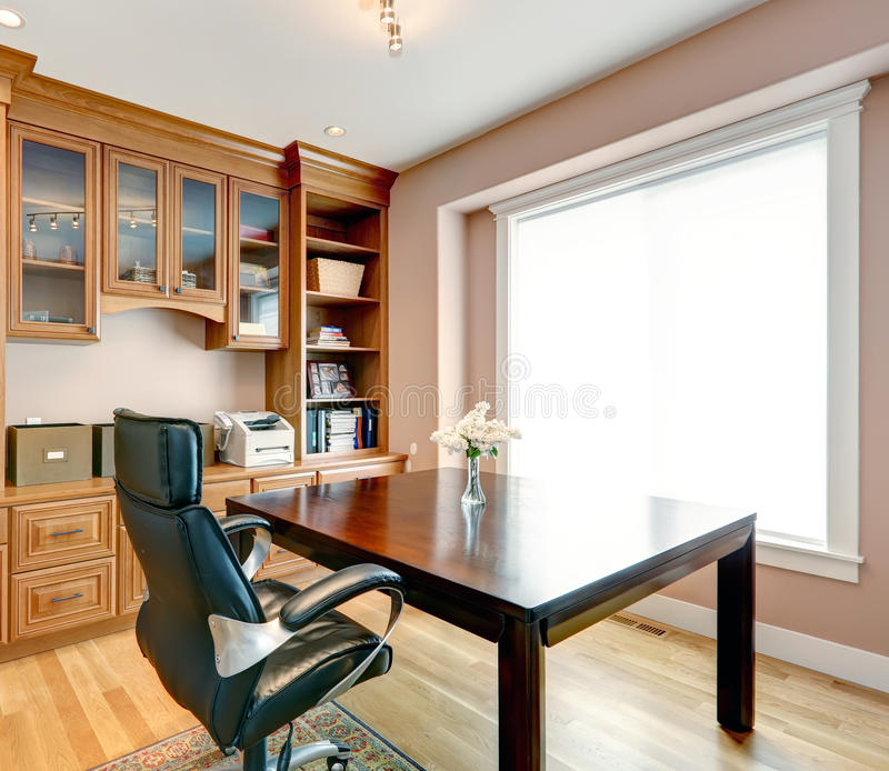 Simple yet elegant office room interior. Office room with storage cabinets, desk and chair stock images