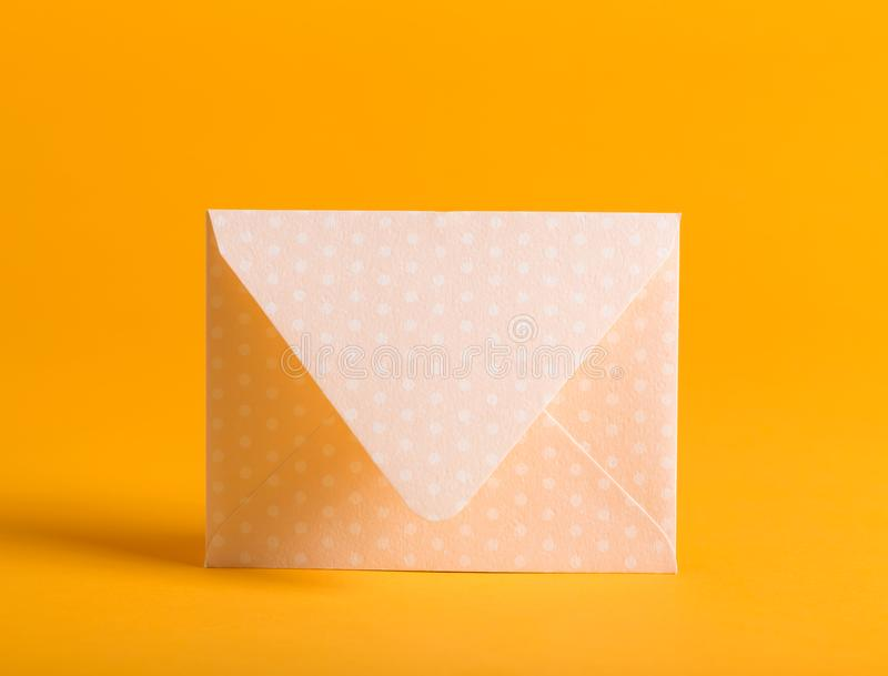 Envelope on a yellow background stock photo