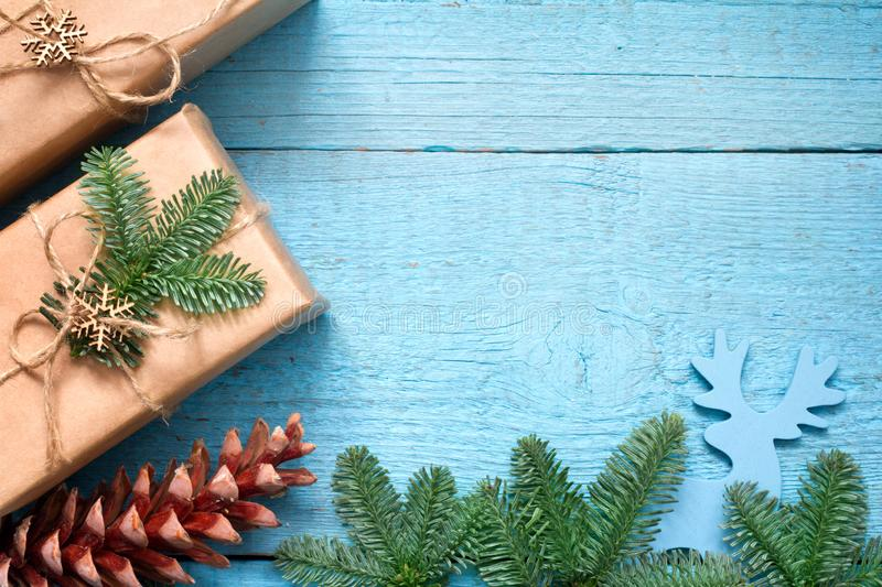 Simple gifts and fir tree christmas ornament decoration on wooden empty blue old background planks. Closeup stock photos