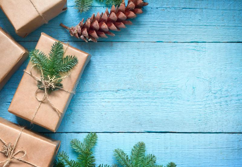 Simple gifts and fir tree christmas ornament decoration on wooden empty blue old background planks. Closeup stock image