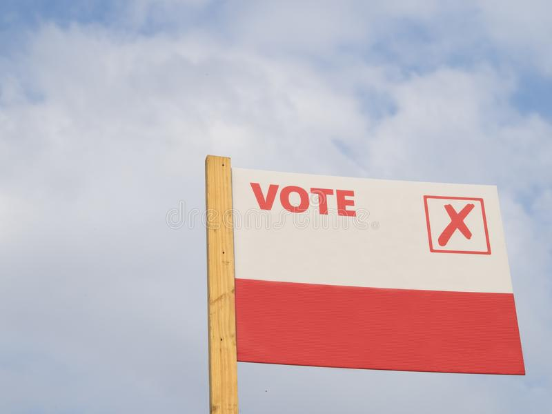 A general sign to vote in elections. A simple and graphic general sign to vote in elections with the tick symbol on plain background royalty free stock images