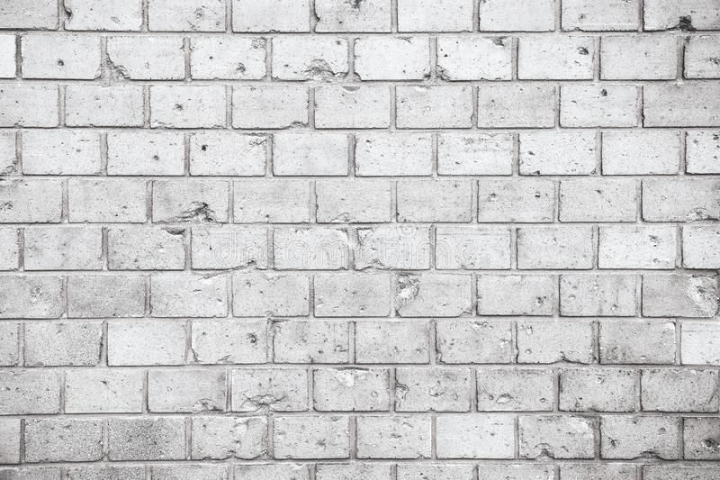 Simple grungy grey white brick wall with light and dark gray shades seamless pattern surface texture background. Wall weathered. royalty free stock photography