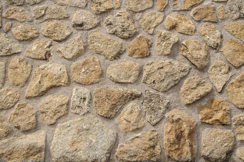 Stone Wall Texture for Background and Design Art Work. Simple grungy stone wall as seamless pattern texture background or as art design overlay. Building old royalty free stock images