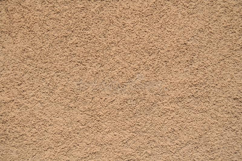 Sand cement wall texture for background and design art work. Simple grungy wall as seamless pattern texture background or as art design overlay. Building old stock photo