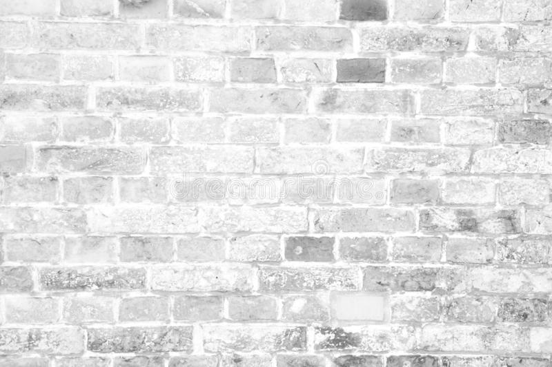Simple grungy white block brick wall surface as seamless pattern texture background.  stock image
