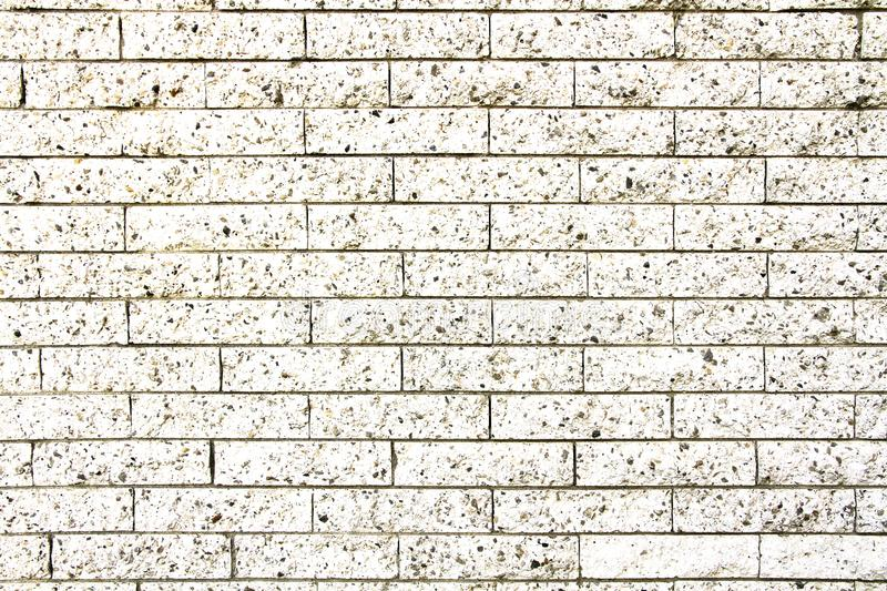 White stone wall: simple grungy white brick stone wall as seamless pattern texture background stock photos