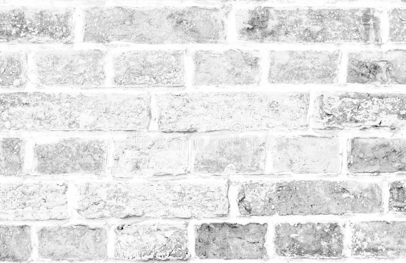 Simple grungy white brick wall surface as seamless pattern texture background.  stock photo
