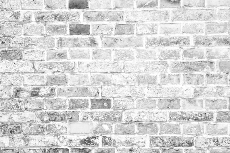 Simple grungy white grey brick wall surface as seamless pattern texture background.  stock photos