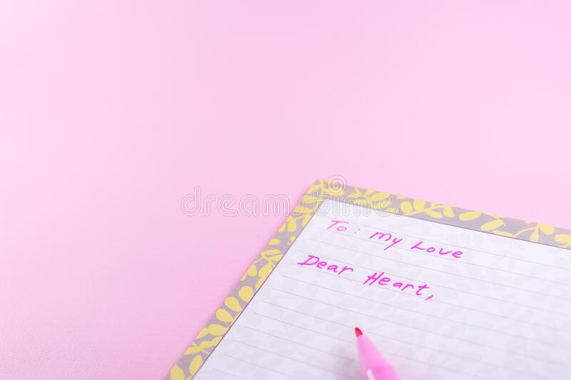 Simple happy valentine day greeting card template with love letter on pink background. copy space field for text. Simple happy valentine day greeting card stock images