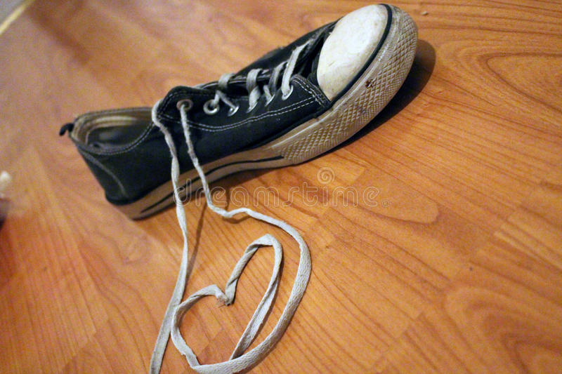 Simple heart and old blue sneaker stock photo