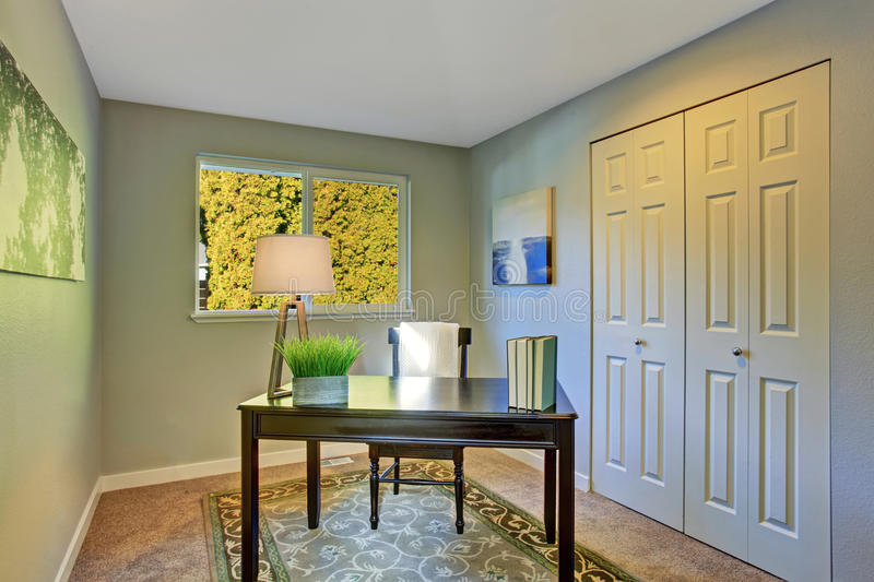 Simple home office room with antique furniture stock photography