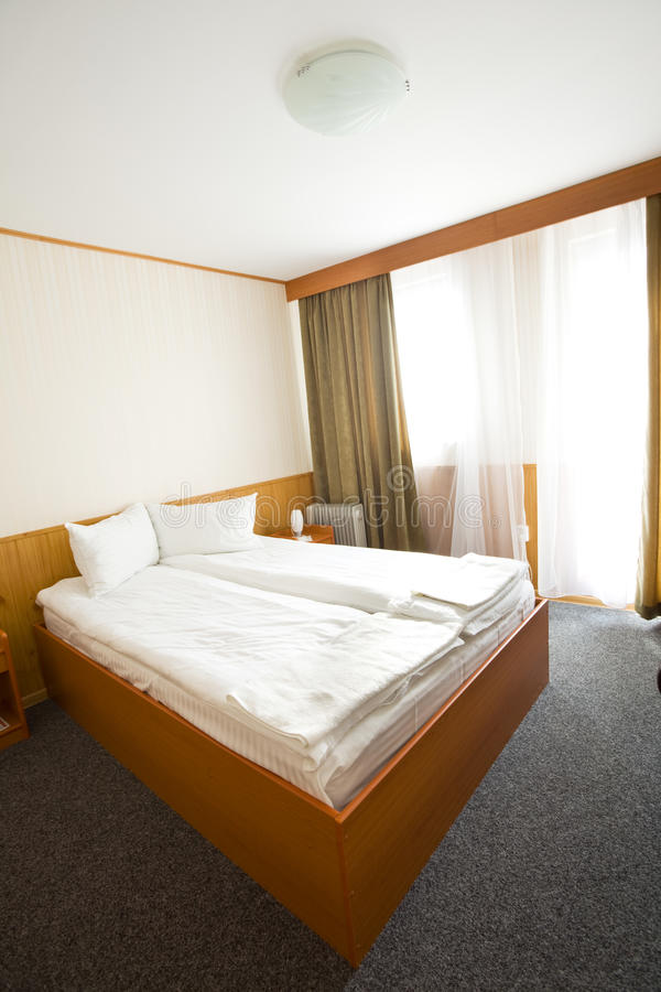 Download Simple hotel or motel room stock image. Image of furniture - 14857773