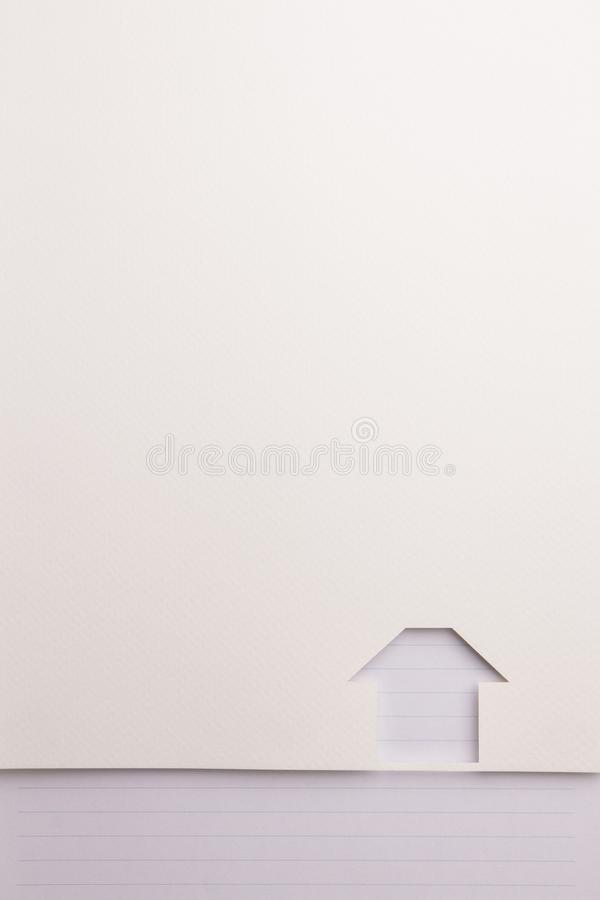 Simple house cutout background by blue line note border. Background of white paper cutout in simple house shape border by blue line notepaper, for home and royalty free stock photos